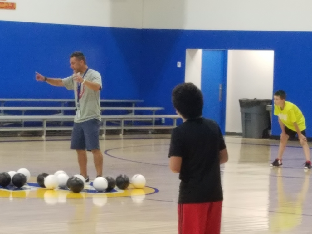 Harkreader inspiring students during physical education.